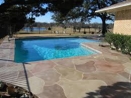 stamped concrete patios make a boring space look expensive
