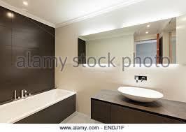 Beautiful Modern Bathrooms - modern black tiled bathroom with basin in glass and wood vanity