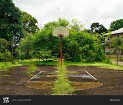 an abandoned outdoor basketball court stock photo offset