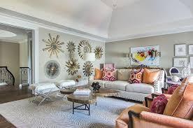 livingroom johnston wall of sunburst mirrors traditional living room
