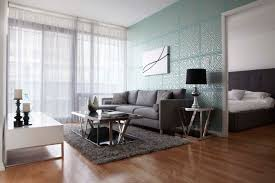 contemporary living room with turquoise geometric wallpaper gray