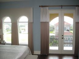 padded valance over palladium windows and drapes over french doors