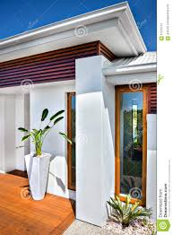 modern house entrance front view of a modern house and blue sky stock photo image