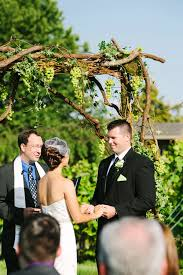 wedding arch grapevine summer wedding at middleburg virginia chrysalis winery event