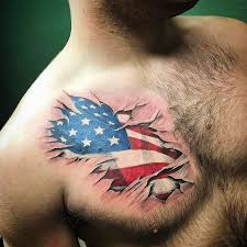 american flag tear through chest tattoo veteran ink