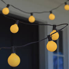 porch lights that don t attract bugs bugs away yellow globe string lights the green head