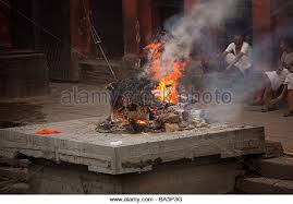 human cremation being cremated bagmati river stock photos being