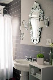 tiny bathrooms with slate walls and ornate mirror and sconces and