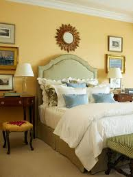 welcoming bedrom designed with yellow wall colors and decorated