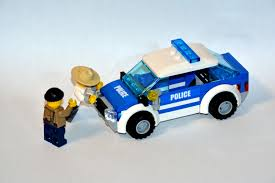 police car toy white and blue police car with two man plastic toy free image peakpx