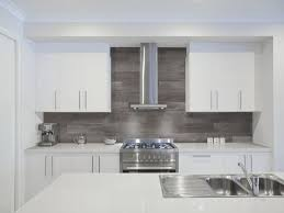 kitchen pendant lighting over island tiles backsplash backsplash stone cleaning solid surface