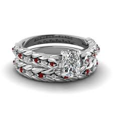 diamond sets design cushion cut diamond leaf design wedding ring set with ruby in 14k