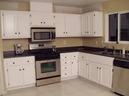 Yellow Kitchen Paint by Brilliant Brown Finished Kitchen Cabinets Also Marble Countertops
