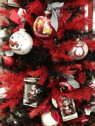 trying to do my entire tree with gamecock ornaments and garnet