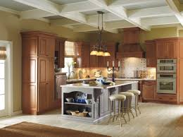 should your kitchen island match your cabinets mix and match your cabinet finishes for a bold look these kemper