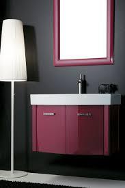 light pink bathroom with wooden washbasin cabinet tile floor