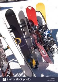 colorful snowboards on a rack near the lodge at brian head ski