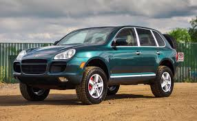 Porsche Cayenne 1st Generation - if you want to get lost in the woods buy this jacked up cayenne