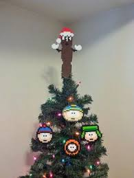 our 8 bit christmas tree ornaments made from perler beads