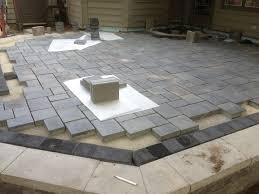 Pea Gravel And Epoxy Patio by Beautiful Patio Using Unilock Brick Pavers Stonehenge Coping