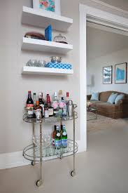 20 small home bar ideas and space savvy designs a vintage bar cart and a few floating shelves is all you need for a tiny