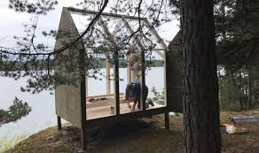 sweden is sending stressed people to these tiny glass cabins curbed