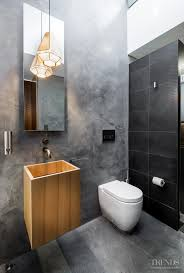 hidden bathroom with smooth concrete walls and plaster walls