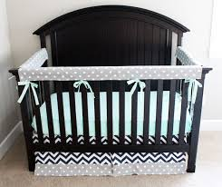 this modern mint navy and gray crib bedding from gigglesix is a