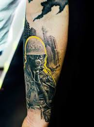 yellow contoured soldier with gas mask tattoo by klaim tattoomagz