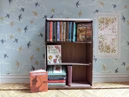 a teeny tiny library illustrated by daniela terrazzini the artworks
