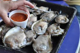 raw oysters crystals sauce and saltine crackers u003d perfect