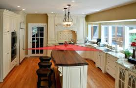 triangle shaped kitchen island triangle pacific kitchen cabinets island stove sink efficient