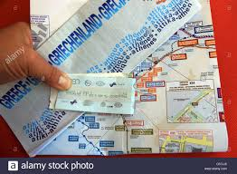 Athens Metro Map by Tourist Hand Holding A Map Of Athens And Metro Tickets And Map
