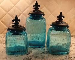 fleur de lis kitchen canisters tuscan fleur de lis teal blue glass canisters ebay