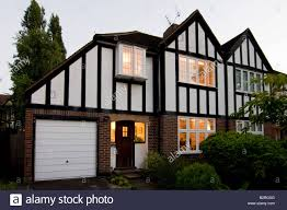uk england surrey semi detached house mock tudor style dusk stock