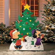 peanuts caroling around the tree decor