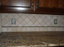cute natural stone tile kitchen backsplash come with brown cream