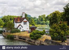 white house near the thames river canal english countryside