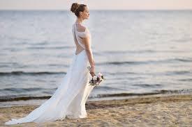 Coast Wedding Dress Bride Walking Along Sea Coast In Wedding Dress Stock Photo Image