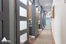 stacked slate and sliding glass doors dental office design by