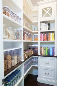 Walk In Pantry Organization | walk in pantry features built in shelving filled with labeled