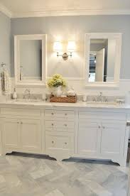 Floor Cabinet For Bathroom A Hint Of Color On The Pristine Bathroom U0027s Walls Coordinates With