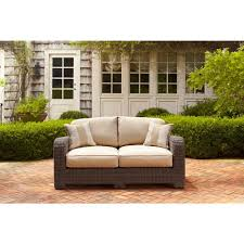 brown jordan northshore patio loveseat with harvest cushions and
