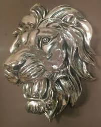 silver lion statue this would be on a garden wall or on a veranda power and