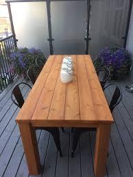 Farmhouse Patio Table by Farmhouse Cedar Patio Table And Metal Dining Chairs Patio