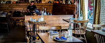 viridian reclaimed wood flooring paneling and restaurant tables