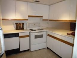 how to paint kitchen cabinets melamine painting kitchen cabinets twobertis