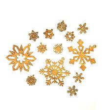snowflake ornaments olive wood snowflake ornaments set of 13 vivaterra