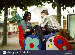 young couple flirting on a chinese bench stock photo royalty free