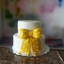 vanilla fondant covered wedding cake and fondant bow bow was